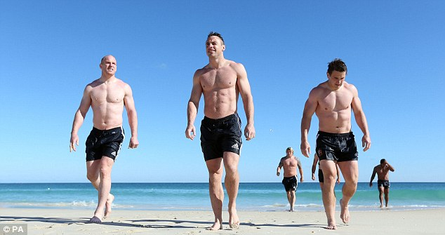 Rug-free: The Lions go bare-chested  in Australia earlier this month