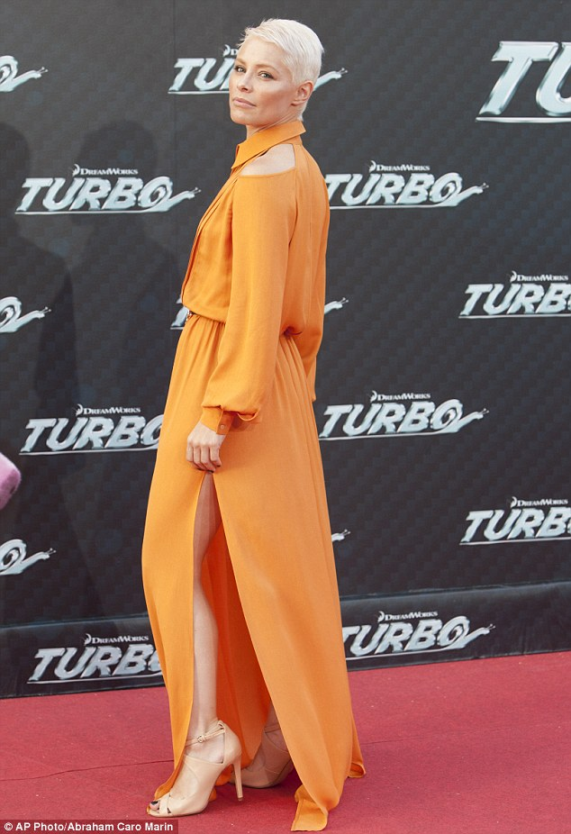 Showing some leg: Soraya Arnelas displayed her toned pins in a billowing orange frock at the Barcelona premiere of Turbo on Tuesday night