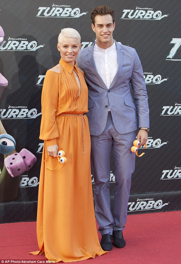 Handsome couple: Soraya posed with her boyfriend Miguel Herrera at the event, both carrying Alice bands with eyes in homage to the snail main character in the film