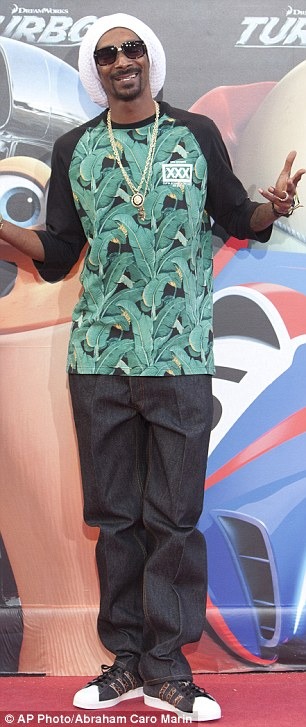 Star power: Samuel L. Jackson looked smart in a shirt and jacket while Snoop Dogg opted for a more casual look