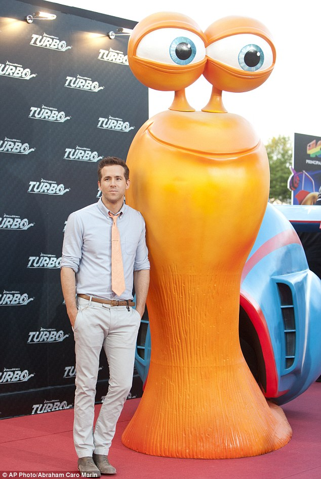 You're me, I'm you: Ryan stood next to the statue of the character that he voices in the film