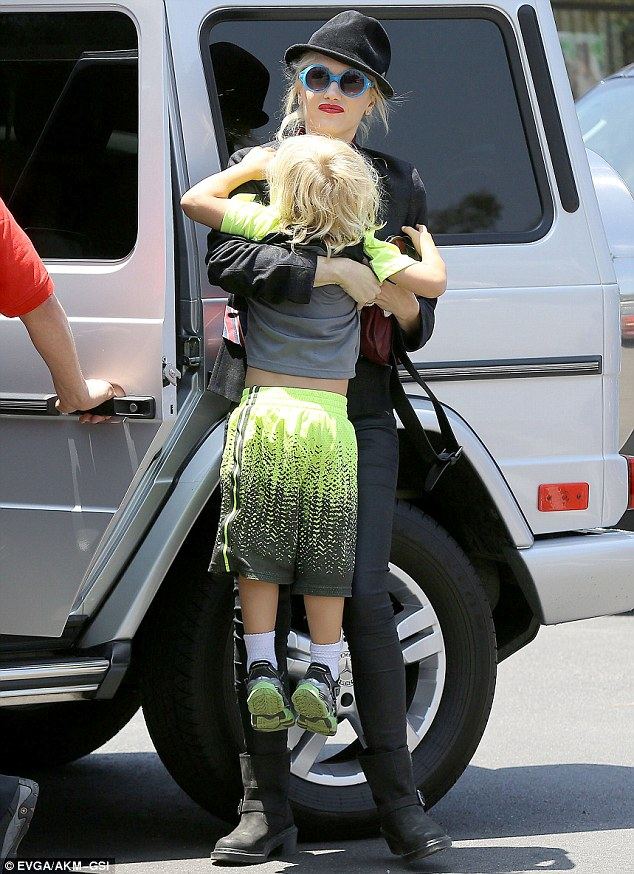 In you go... Gwen helped her little one get in the van as they left their errands