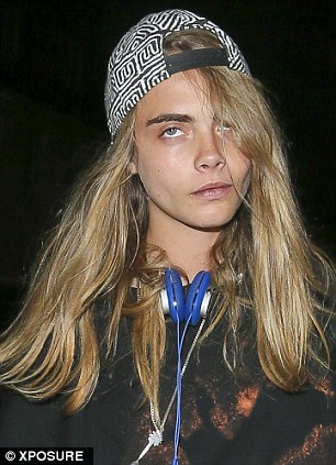 Bleary-eyed: Cara looked exhausted and dishevelled as she made her way back to her London home