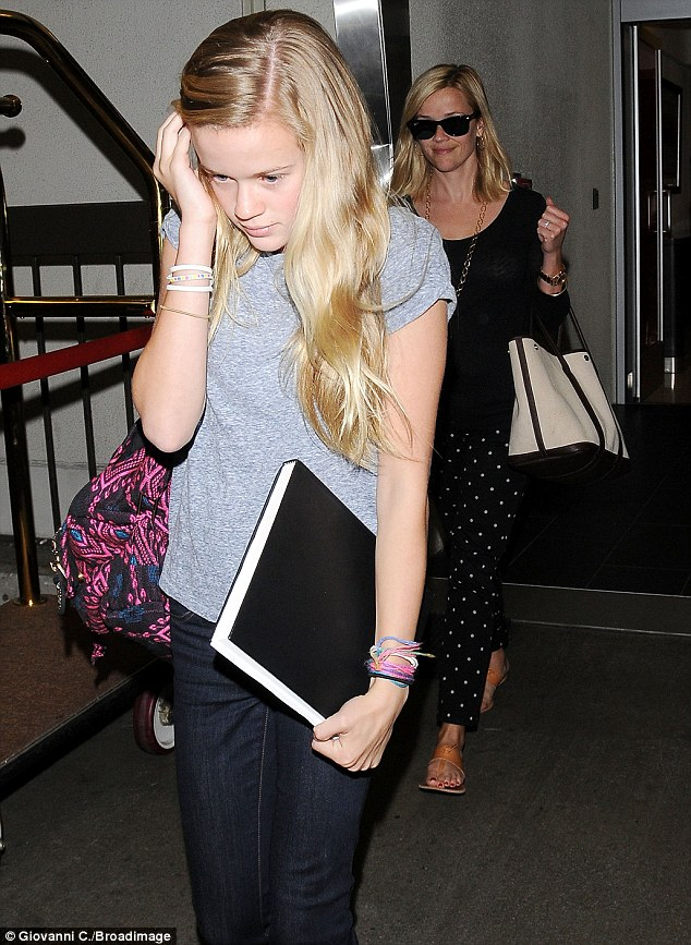 Mini me: Reese was joined by her 13-year-old Ava Phillippe at the airport
