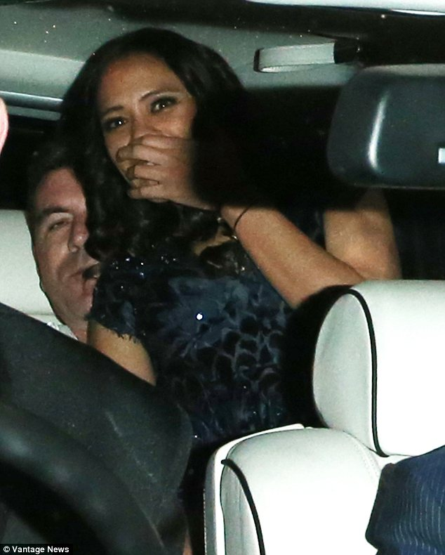 Who's that lady? Simon Cowell left a restaurant on Tuesday night with a mystery woman sat on his lapwoman