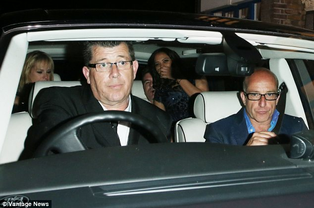 Full car! The music mogul left the River Cafe with two women in his back seat and a male friend in the front