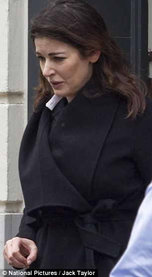 Glum: Nigella Lawson seen leaving the rented Mayfair flat where she has been staying since her husband was pictured throttling her in a restaurant
