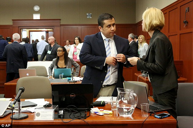 George Zimmerman speaks with attorney Lorna Truett: He has claimed self-defense, saying he opened fire after the teenager jumped him and began slamming his head against the concrete sidewalk