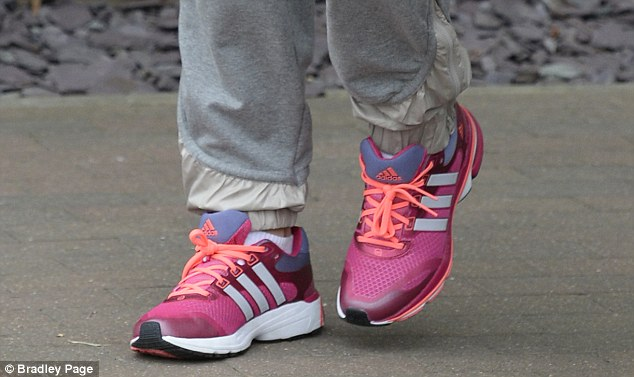 In demand: Laura Robson meets fans following a practice session, in which she wore pink shoes (below)