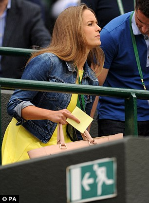 Taking position: Kim Sears settles at court side to watch Andy Murray play Yen-Hsun Lu