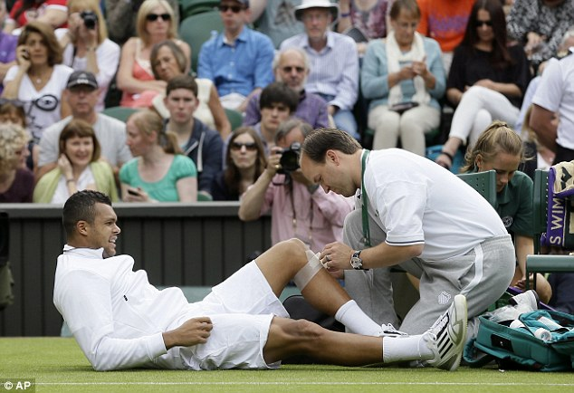 Receiving treatment: Jo-Wilfried Tsonga picked up an injury after losing the second set