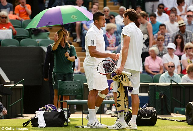 Over and out: Jo Wilfried Tsonga (left) retired injured in his match with Ernests Gulbis