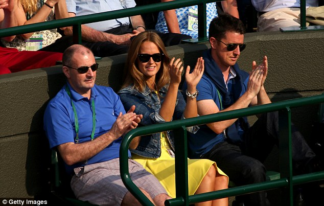 Shining with Murray: Kim Sears watches Andy Murray on Court 1