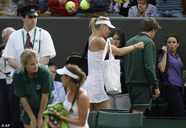 Shock result: Maria Sharapova needed treatment during her surprise defeat to Michelle De Brito