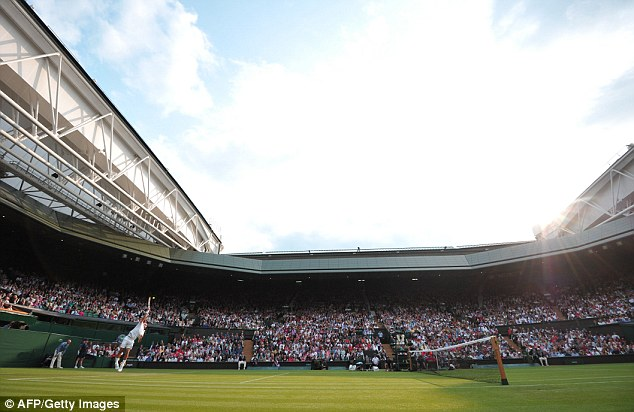 Taking a tumble: Sergiy Stakhovsky slips during his match against Roger Federer