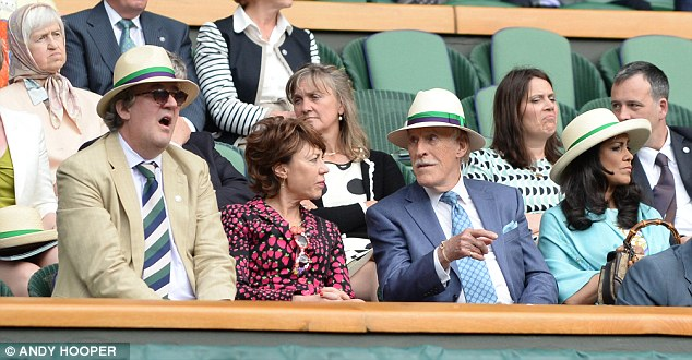 Nice to see you: Stephen Fry (left) and Bruce Forsyth (second right) watched the action on Centre Court