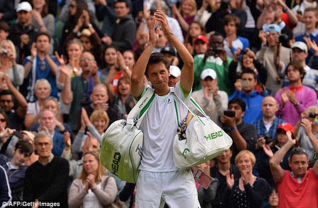Seize the moment: Stakhovsky celebrates with the crowd after defeating Federer, who quickly departed