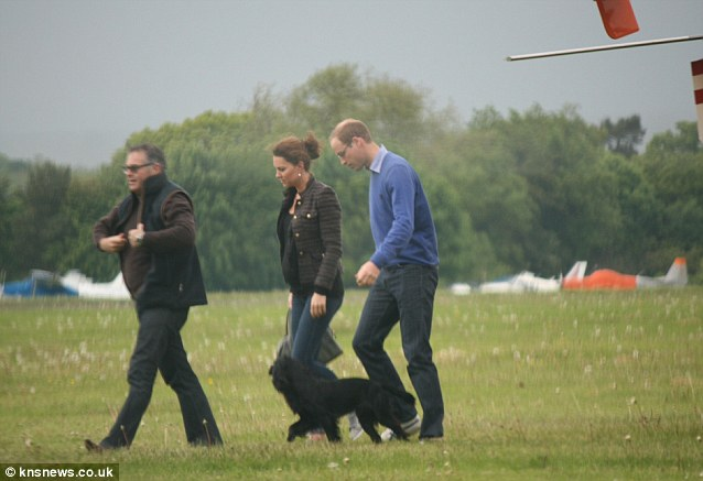 Homeward bound: The Duke and Duchess of Cambridge and dog Lupo with Simon Oliphant-Hope after landing at Denham, south Buckinghamshire