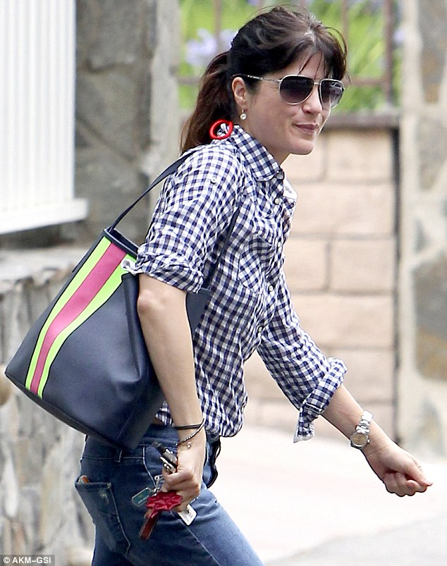 Bright and cheery: She also kept her spirits up in Studio City, California that day