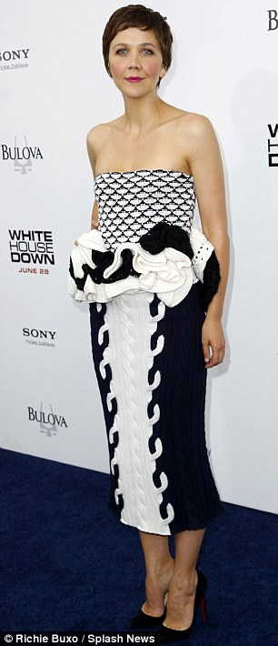 Garish get-up: The actress donned a black and white dress as she graced the navy blue carpet
