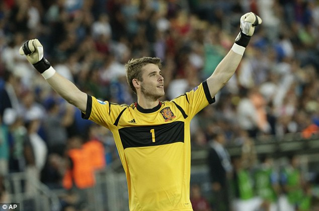 Winner: De Gea celebrates after Spain clinched the European Under 21 Championship title against Italy and (below, second left) with the trophy