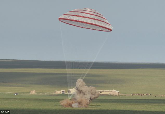 China's Shenzhou 10 spacecraft is shown landing in Siziwang Banner, north China's Inner Mongolia Autonomous Region on Wednesday.