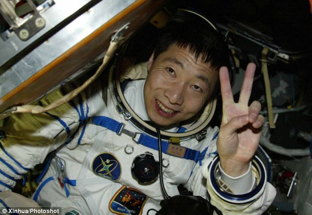 This photo was taken in 2003 and shows astronaut Yang Liwei getting out of the re-entry capsule of China's Shenzhou-5 spacecraft.