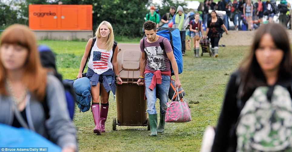That's one way to carry your stuff! Ffion Humphries, 21, and Rhys Wright, also 21, from mid-Wales, brought a big brown wheelie bin with them - but still had to carry extra bags and rucksacks
