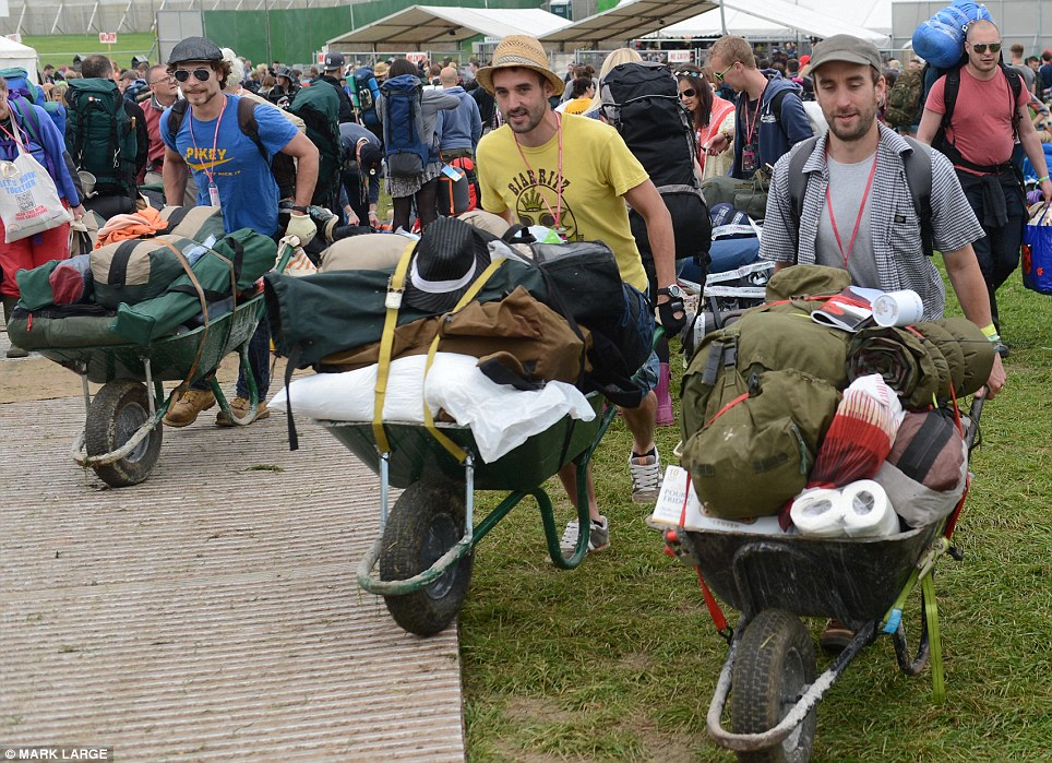 Wheelie good fun: Three men chose this novel way of carrying their belongings into the festival site