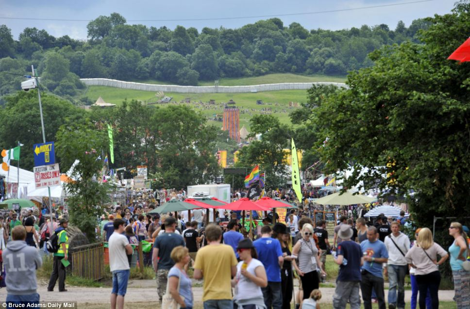 Settling in: Music fans get settled on the sprawling site ahead of the start of the festival