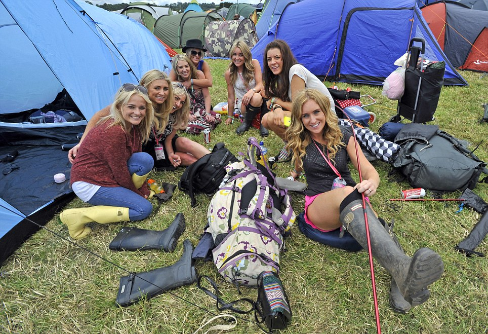 Festival fans from Merseyside take a break from putting their tents up on the first day of Glastonbury 2013 today
