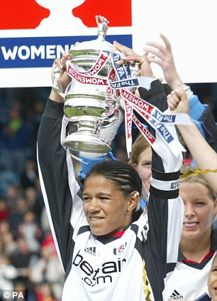 Yankey lifting the Women's FA Cup trophy for her team Fulham in 2003