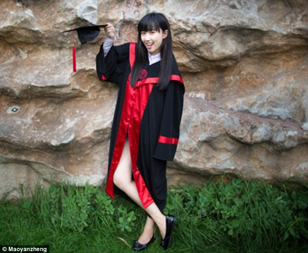 Hats off: Kang Kang does not appear to have too much on beneath her graduation robes