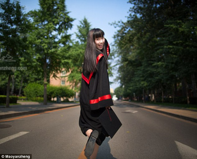 Spring in her step: Kang Kang has now been dubbed the 'Goddess of Renmin University of China'