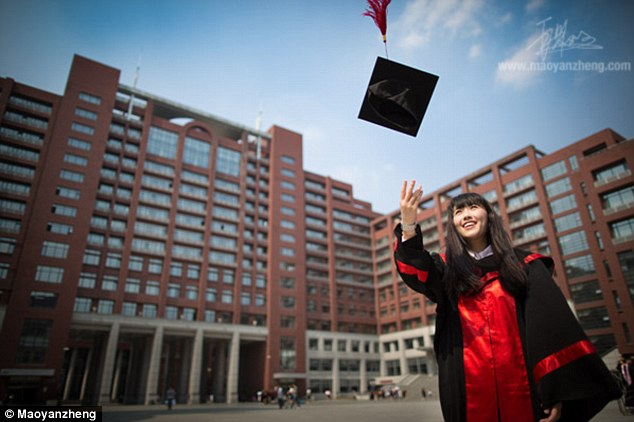School's out: The pretty student tosses her mortarboard hat into the air in front of the university building