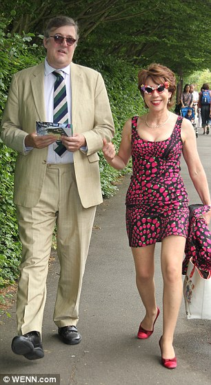 Spectators: Broadcaster Stephen Fry and author Kathy Lette are pictured arriving at Wimbledon