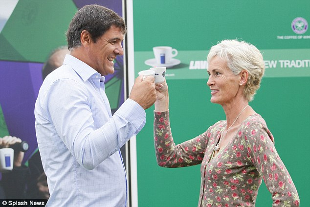 Cheers: Andy Murray's mother Judy Murray and Rafael Nadal's uncle Toni Nadal serve coffee to spectators queuing up for tickets for the Wimbledon Championships, as well as answering questions from reporters