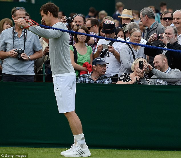 Getting ready: Andy Murray of Britain warms up today during a practice session on day three of Wimbledon