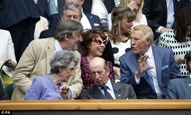 Celebrities galore: Sir Bruce Forsyth (right) speaks to Stephen Fry (left) in the Royal Box on Centre Court