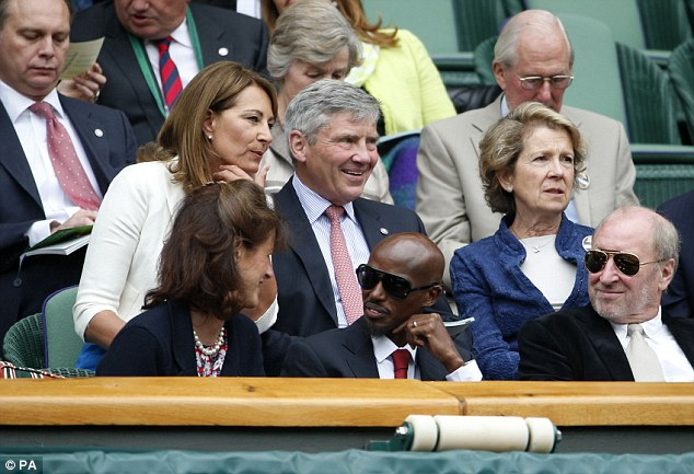 Famous faces: Michael (centre) and Carol Middleton sit near Mo Farah (bottom centre) in the Royal Box