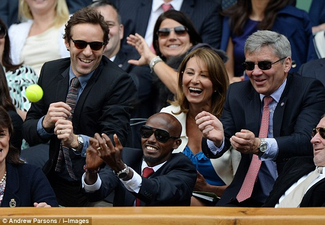 Going for it: Mo Farah attempts to catch a tennis ball from Centre Court, while sitting in the Royal Box in front of Michael and Carole Middleton, the parents of the Duchess of Cambridge, and actor Alessandro Nivola (left)