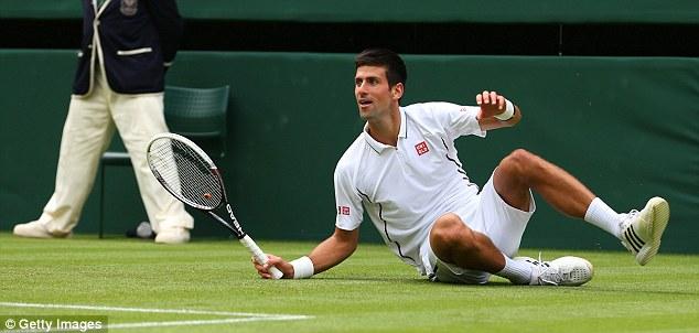 Tumble: Even world No 1 Novak Djokovic struggled to keep his footing