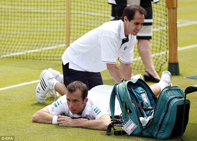Hurting: Radek Stepanek receiving treatment in his match with the giant Pole Jerzy Janowicz