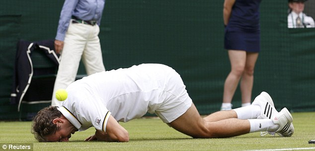 Crooked: France's Julien Benneteau went down after twisting his knee