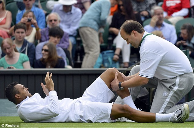 Unlucky number seven: Jo-Wilfried Tsonga has became another casualty at Wimbledon