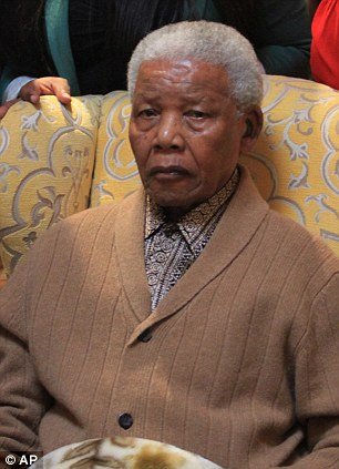Positive signs: Nelson Mandela is 'showing great improvement', according to his ex-wife