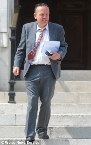 Tony McGuire (pictured today) has been spared jail after destroying his family's £300,000 home with a sledgehammer
