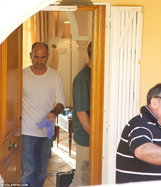 Probe: Detectives investigating the triple deaths are pictured inside the property