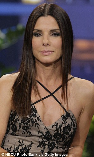 Sleek: Sandra had her hair out in a straight style and applied a smokey eye and nude lip for make-up