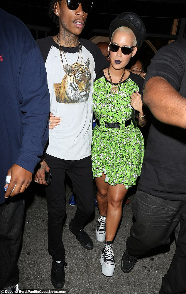 Engaged: Amber and rapper Wiz became engaged in spring 2012 after dating a year